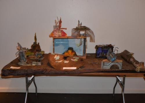 "Francesca Borgatta Dioramas: ""Table with Small Shrines"" (from interactive installation ""Ships and Shrines""), 24″×96″×30″"